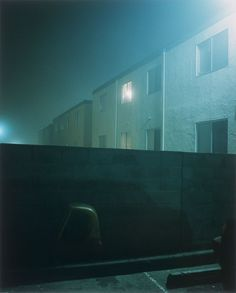 "Todd Hido.  ""I'm an art photographer,"" Hido explained. ""I just do photos of suburban neighborhoods. Long-exposure stuff.""    ""Well,"" the guy said, ""be careful. The cars come roaring through here.""    ""Yeah, thanks."""