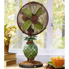 Table Top Fan/Lamp - Mosaic Glass Pineapple Add a touch of Deco class and a subtle taste of the tropics to your decor with the Mosaic Pineapple Fan. Doing triple duty as a piece of finely crafted art, a fully functional fan, and a night light, the Pineapple Design, Tropical Design, Tropical Decor, Tiffany Style Table Lamps, Art Deco, Fan Lamp, Vintage Fans, Reno, Glass Table