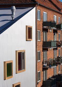 Ama'r Children's Culture House by Dorte Mandrup is an aluminium-clad children's centre in Copenhagen