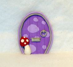 purple polka dot fairy door ornament. measures around 8cm tall. A fairy door would make a great unique gift. Suitable for both adults and