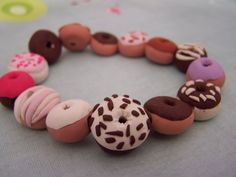So cute! A Clay donut bracelet! Wouldn't it be cute with cupcakes too?