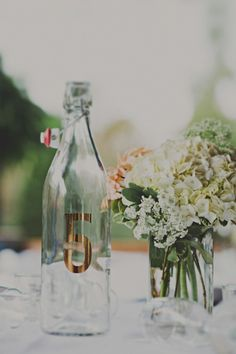 table numbers on water bottles - with tags or put numbers right on the bottle