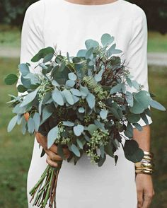 A DIY Wedding, With a Ceremony in a Pool   Martha Stewart Weddings - The bride's bouquet was crafted from different types of fragrant eucalyptus, which Jessie chose because of its soothing scent.