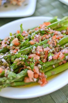 This Asparagus with Catalan Salsa Vinaigrette recipe is a healthy vegetarian side dish. Capers, tomatoes, red onions and chopped parsley are adde…