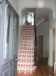 Orla Kiely wallpaper on risers, via Happily Nested