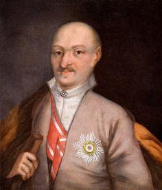 Stanisław Małachowski | krojczy koronny, | starosta wąwolnicki, | pułkownik znaku | pancernego wojsk J.K. | Mości, kawaler | orderu śtego. Stanisława | zmarł 1784 r.