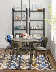 Mark Daniel's warm design makes a study of neutral grey-toned wood and industrial-inspired metal cross bars and brass grommets, achieving high marks for the table's clean, structural feel with home-worthy appeal.  Small in size but big in style, the table fits right into kitchen nooks or open eating areas to seat 4.