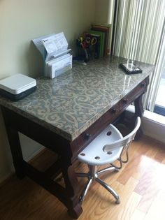 Did this myself - just refinish a thrift-store desk, glue on some pretty cloth and pour on high-gloss epoxy resin. by jeanette