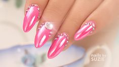 Suzie creates a dazzling Barbie Nail Design using Pink Gel Polish, Blue Chrome Powder, and Blings It Up with Jewels! Find out how using Chop Sticks can help ...