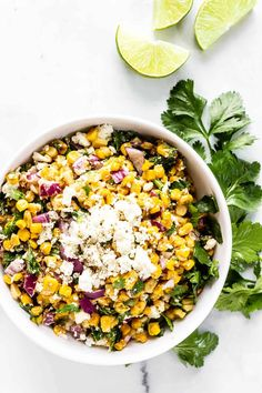 Mexican Street Corn Salad (Esquites) - Our favorite Mexican street corn is turned into a tangy, creamy, and slightly spicy corn salad perfect for cookouts, backyard BBQs, or an easy weeknight dinner. This perfect summer side dish is tasty with grilled chicken, steak, or your favorite seafood. #esquitesrecipe #mexicanstreetcorn #salad #salads #glutenfree #vegetarianrecipes