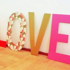 DIY room decor....I could cut letters out of cardboard and then draw/paint them and hang it on my wall. :D