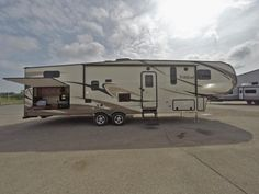 "FAMILY FUN BUNKHOUSE FIFTH WHEEL!  2017 Forest River Wildcat 32BHX The comforts of home will never be far, with residential furniture and an impressive executive chef kitchen, to name a few! This RV sleeps 7 people, bring the whole crew along! The 32BHX is 36'7"" long, has a shipping weight of 1,630 pounds, and has a holding tank capacity of 60-68-34 gallons. Give our Wildcat expert Mike Taravella a call 517-604-1908 for pricing and more information."