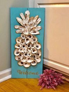 Customize able pineapple welcome signs! The perfect house warming gift!  Size 11x24  1. Choose your background color 2. Let us know if you want the shells gold trimmed or plain