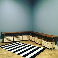 PLAYROOM DESIGN: DIY galvanized pipe and stained pine bench. Crates with added casters for toy storage.