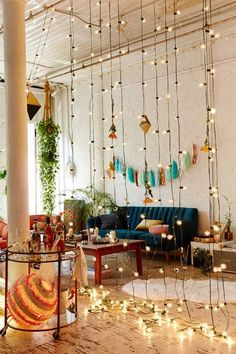a curtain of string lights can be a nice idea to add some light to the interior and divide it into zones