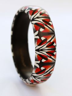 Striking contemporary bangle, red and black in a geometric 'art nouveau' pattern. Beautiful one-of-a-kind bracelet by DoodlePippin