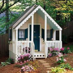 Style on the Sly! A delicately detailed garden shed sits on what could be a…