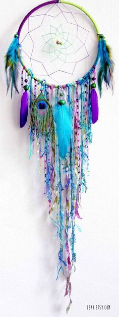 *DIY Blue Feather and Bead Dream Catcher. This dream catcher is an attractive one made with blue purple ribbons and feathers. It not only catches a dream for a good night's sleep, but certainly does wonders to your decor. Los Dreamcatchers, How To Make Dreamcatchers, Dreamcatcher Feathers, Beautiful Dream Catchers, Diy And Crafts, Arts And Crafts, Kids Crafts, Diy Art, Wind Chimes