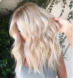Unique ash white hair color ideas , ombre white blonde Hair color for summer, Unique wavy hairstyle with layers for medium length hair #hair color #hairstyle #medium-length hair, #balayagehairblonde