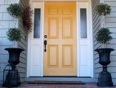"""Benjamin Moore """"Stuart Gold"""" (HC-10) for the front door - love it!"""