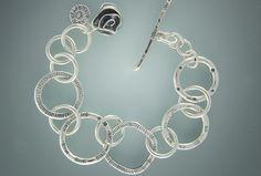 "7st 271 - Sterling Silver ""Marlene"" Bracelet, Heavy Gauge Stamped Rings. Reversible & Adjustable."