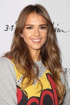 Jessica Alba wears her warm light brown hair in loose curls with blonde tips.