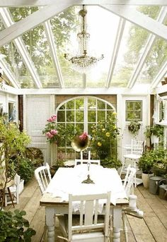 Conservatory/sunroom - would be awesome as a dining room off the kitchen!  Could do an indoor garden - flowers, herbs, all kinds of fun! :-)