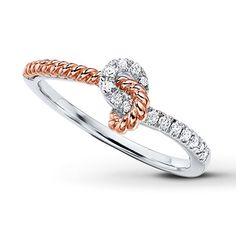 A legendary Chinese proverb states that an invisible red thread connects those who are destined to meet, regardless of time, place or circumstance. The thread may stretch or tangle, but it will never break. This charming ring features a strand of 10K rose gold to bring the Legend of the Red Thread to life. Round diamonds, totaling 1/8 carat in weight, twinkle along the sterling silver band. Diamond Total Carat Weight may range from .115 - .14 carats.