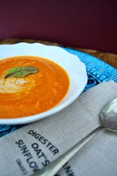 Creamy Butternut Squash and Tomato Soup - butternut squash, onion, garlic, olive oil, canned tomatoes, tomato puree, cumin, ginger, salt/pepper and vegetable stock