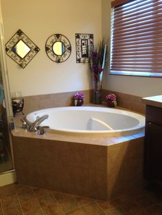 decorating around a bathtub | the happier homemaker | home