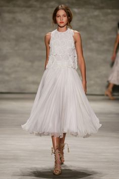 View the Luis Antonio Spring 2015 RTW collection. See photos and video of the S2015RTW runway show. Luis Antonio