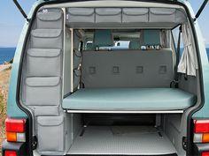 Utilities VW T4 (European?) -- the custom bags are an interesting idea for organizing and using a thin space. I'd add labels for contents.