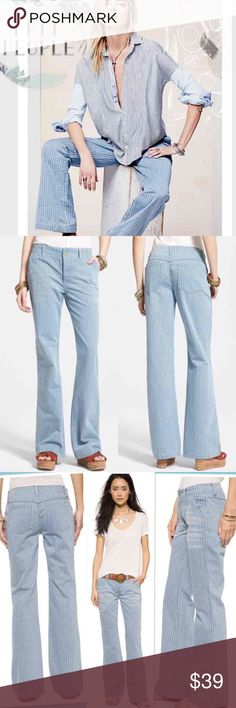 "NWT Free People Railroad Stripe Flare Jeans Pants Cotton denim jeans encapsulate two distinct fashion eras with crisp railroad striping and a funky flare below the knees. 32"" inseam Zip fly with button closure. Side slant pockets; back patch pockets. 100% cotton. Color: Solar Blue Size 28 New with tag....$128.00 Free People Jeans Flare & Wide Leg"