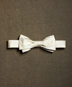 Ivory/gold bowtie for groomsmen. Brooks Brothers. Definitely my top pick.