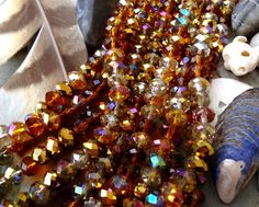 Faceted Crystal Puffy Rhondelle, 8x5mm, Amber Glow, Designer Crystal Mix by DragonflyBeadsStudio on Etsy