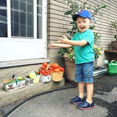 """""""Tada""""  Victor shows off his #harvest  I love that he helps me collect everything in the garden. Then he quickly gets tired pulls up a chair and watches me do the rest"""