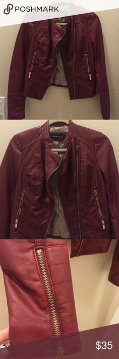 Burgundy faux leather jacket Label is Black Rivet. This is a size xs. Faux leather jacket with gold zipper detail. There are zippers on the arm and seams for moto feel. The front is a slight asymmetrical zipper. Black Rivet Jackets & Coats