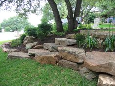 Consider boulder/retaining wall to push back bank to make porch bigger