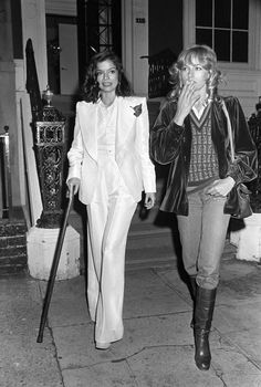 Le Smoking: classic and modern takes on Yves Saint Laurent's iconic ladies' tuxedo. Bianca Jagger, 1974