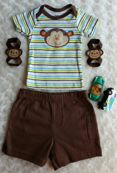 A Cute Baby Boy Monkey Outfit.  The size on it says Newborn but it also says 5-8 lbs. This is running small.  Newborn Boy Barefoot sandals.