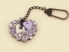 Fun Craft Project: Turn a traditional magic clay cane into a cute heart shaped key chain! This Magic Cane Heart Key Chain is an easy polymer clay craft that anyone can do. Use colors of your own choosing to make something really unique.