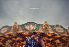 Carnival engagement, under the merry go round.