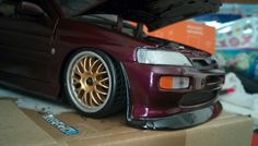 1:18 Ford Escort Cosworth Jewel Violet Modified with Gold BBS Wheels