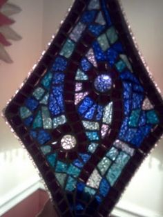 Glass on glass mosaic, perfect for a candy/nut dish or beautiful hanging in front of a light or mirror