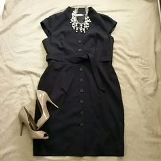 NWT Calvin Klein dress Navy blue, button up, cap sleeve Calvin Klein dress with tie at waist. Very figure flattering! Calvin Klein Dresses Midi