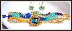 NAVAGIO - SHIPWRECK OF MY DREAMS SET UNICAT brătara si cercei Tehnici: broderie cu margele, peyote Materiale: margele japoneze Toho, cehesti, Murano, de lampa, pietre semipretioase, cristale, etc UNIQUE SET bracelet and earrings Design si realizare Mireille Colours Bijuterii Design, realization by Mireille Colours Bijoux Techniques: beads embroidery, peyote Materials: japanese Toho beads, Czech crystals, semiprecious stones, Murano beads, lamp, gold plated terminations