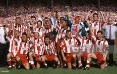 Stoke City manager Lou Macari (front row, centre) holding the trophy as the Stoke City team celebrate following the Autoglass Trophy Final between Stoke City and Stockport County at Wembley Stadium in London, 16th May 1992. Stoke City won 1-0.