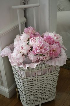 Oh this white wicker basket with the pink ribbon and beautiful flowers would look so beautiful in my Parisian/Shabby Chic Living Room