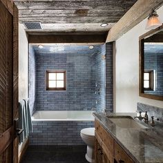 An unexpected pairing: deeply worn wood with Frost tiles. Design: @clbarchitects. : Paul Warchol