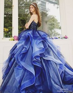 This ombre blue gown from Kiyoko Hata featuring dreamy ruffles is incredibly breathtaking! » Praise Wedding Community